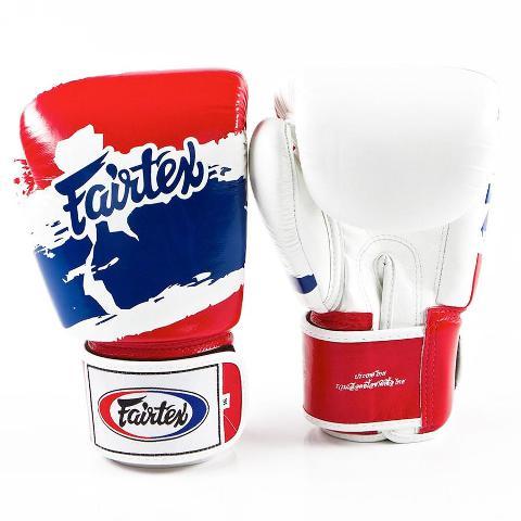Тренировочные перчатки на липучке Fairtex Thai Pride, 14 oz  FairtexБоксерские перчатки<br>Универсальные тренировочные перчатки для Кикбоксинга, Бокса и Муай Тай. Прекрасно подойдут для тренировочных спаррингов, работы на мешках и на лапах. Это лимитированная серия, выполненная в национальных цветах королевства Таиланд. Модель выпущена: 14 oz. Качественная ручная сборка. Материал - натуральная кожа. Наполнитель пена с хорошей амортизацией ударов.<br>