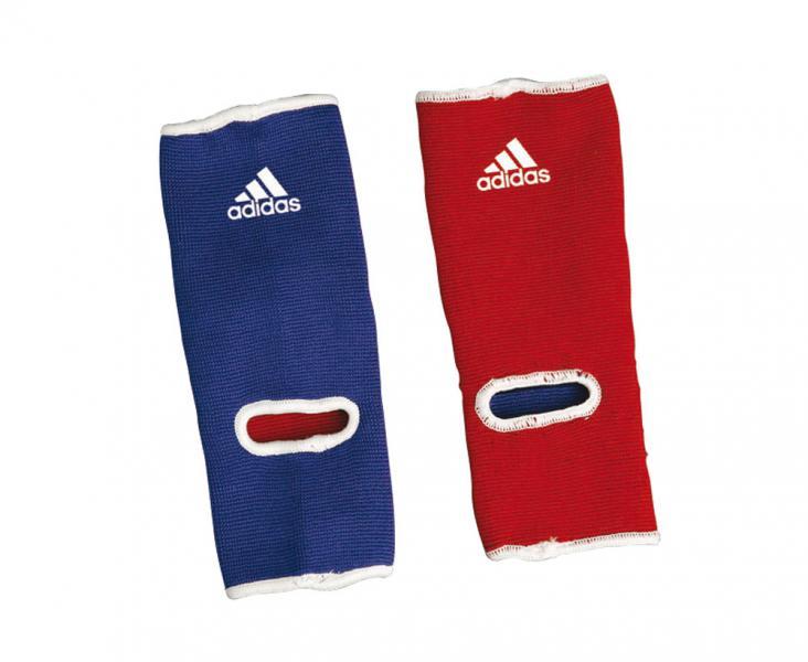 Защита голеностопа двухсторонняя Reversible Ankle Pad сине-красная AdidasЗащита тела<br>Защита голеностопа двухсторонняя Reversible Ankle Pad adidas сине-красная. Специальный эластичный материал.  Два цвета в одномМатериал: хлопок с полиэстром<br><br>Цвет: сине-красная