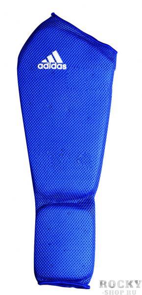 Защита голени и стопы Shin and Step Pa, синяя AdidasЗащита тела<br>Защита голени и стопы adidas Shin-n-Step Pad с мягкой защитой из EVA пены с высокой плотностью. Имеет эргономическую форму, удобно и плотно фиксируются на ноге. Идеально подходят для защиты голени-стопы, также используется в качестве дополнительной защиты под жесткие щитки. Эргономическая форма. Плотная и удобная посадка. EVA пена высокой плотности.<br><br>Размер: M