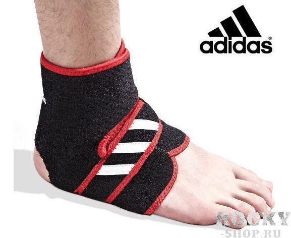 Суппорт голеностопа регулируемый Adjustable Ankle Support черно-красный AdidasАксессуары для фитнеса<br>Комбинация сетчатой ткани и неопрена позволяет сделать бандаж, который идеально повторяет анатомию. Бандаж Adidas создан для поддержания суставов и компенсации слабости мягких тканей.<br>