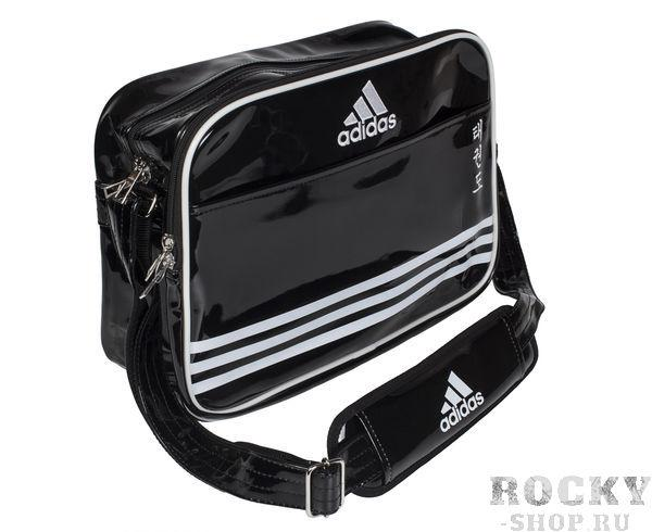 Сумка спортивная Sports Carry Bag Taekwondo S, черно-белая AdidasСпортивные сумки и рюкзаки<br>Сумка adidas с лямкой через плечо. Иероглифы Taekwondo. Материал: искусственная кожа. Размер S [38х23х16]<br>