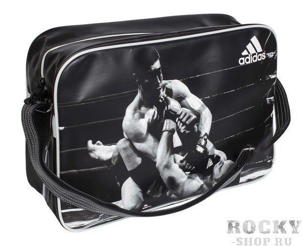 Сумка спортивная Sports Bag MMA L, черно-белая AdidasСпортивные сумки и рюкзаки<br>Сумка adidas с лямкой через плечо. Принт ММА. Материал: искусственная кожа. Размер:[47х32х17]<br>