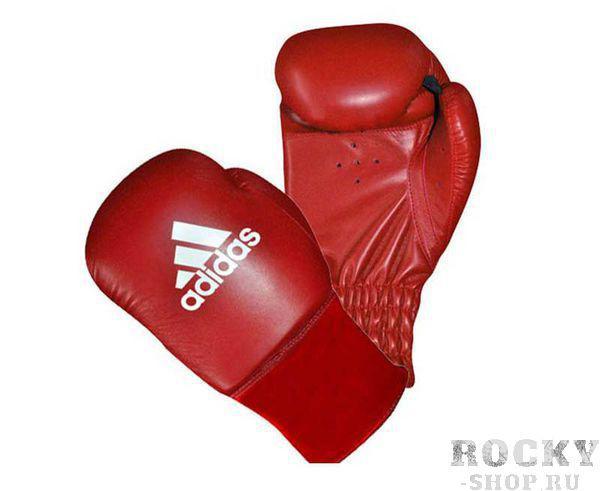 Перчатки боксерские Rookie красные, 6 унций AdidasБоксерские перчатки<br>Перчатки боксерские adidas Rookie-2 красные. Любительские боксерские перчатки для детей и подростков. Травмобезопасные. Полиуретан по технологии PU3G INNOVATION. Композитный литой вкладыш по технологии I-PROTECH. Усиленная защита большого пальца. Фиксируется на руке с помощью резинки.<br>