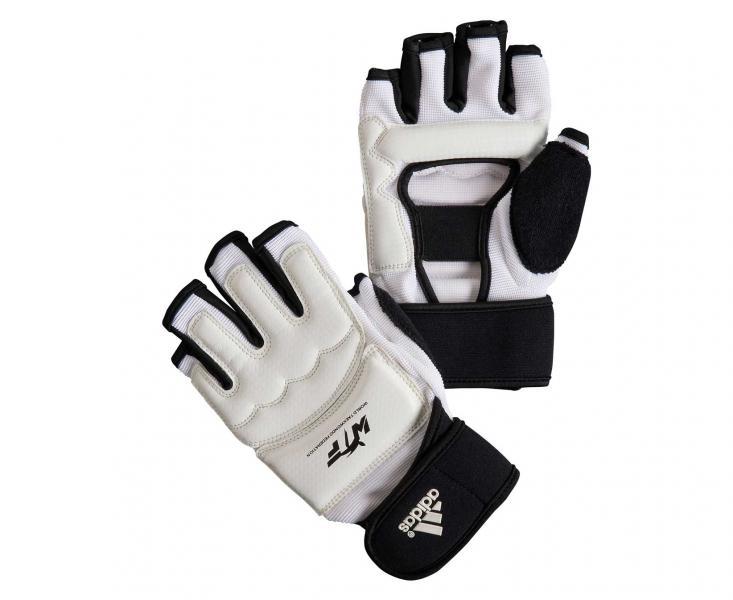 Перчатки для тхэквондо WTF Fighter Gloves, белые AdidasЭкипировка для Тхэквондо<br>Боевые перчатки adidas для тхэквондо WTF и других видов единоборств.        Используются многими сборными по тхэквондо   WTF approved   Застежка на липучке   Материал: полиуретан<br><br>Цвет: XS