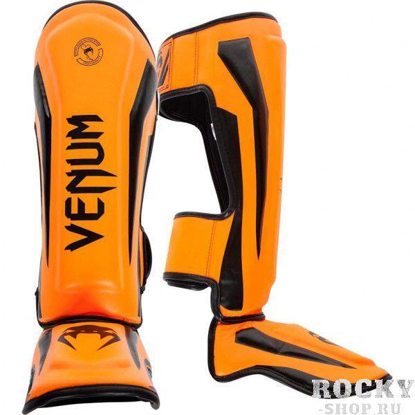 Щитки Venum Elite Neo Orange VenumЗащита тела<br>Щитки Venum Elite Neo Orange полностью ручной работы, созданы для того, чтобы обеспечить элитных бойцов лучшей защитой. Сделаны из синтетической кожи , сочетают в себе комфорт и высокую прочность по вменяемой цене. Анатомические крепления на голени и подъеме обеспечивают максимальную защиту и удобство пользования. ОсобенностиПремиум кожа SkintexВысокоплотная пена с дополнительной набивкой в области голени и подъема для повышенной амортизацииЛегкая конструкция обеспечивает неограниченную мобильность и скоростьБольшие застежки-липучки не дадут щиткам прокручиватьсяРельефные логотипыРучная работа, Тайланд<br><br>Размер: M