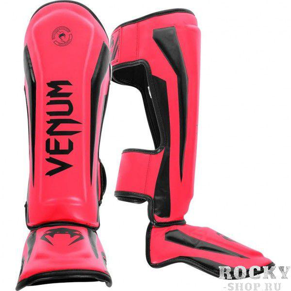Щитки Venum Elite Neo Pink VenumЗащита тела<br>Щитки Venum Elite Neo Pink полностью ручной работы, созданы для того, чтобы обеспечить элитных бойцов лучшей защитой. Сделаны из синтетической кожи , сочетают в себе комфорт и высокую прочность по вменяемой цене. Анатомические крепления на голени и подъеме обеспечивают максимальную защиту и удобство пользования. ОсобенностиПремиум кожа SkintexВысокоплотная пена с дополнительной набивкой в области голени и подъема для повышенной амортизацииЛегкая конструкция обеспечивает неограниченную мобильность и скоростьБольшие застежки-липучки не дадут щиткам прокручиватьсяРельефные логотипыРучная работа, Тайланд<br><br>Размер: M