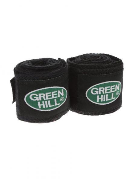 Бинт боксерский, эластичный, 2.5 метра, 2,5м Green HillБоксерские бинты<br>Материал: Хлопок - ПолиэстерВиды спорта: БоксБинт боксерский Green Hill, сделан из хлопка с добавлением эластика, растягивается, обеспечивает плотное стягивание кистей рук, крепиться на липучке. Боксерский бинт используется для бинтования кистей рук, для предотвращения травм суставов пальцев, обеспечивается такая защита путем плотного стягивания пальцев бинтом друг к другу, что создает единую площадь удара и способствует распределению нагрузки, так же бинт полезен во время тренировок, впитывая пот ладоней, не давая загрязняться внутренней части перчаток. <br> Изготовлен из полиэстера и хлопка<br> Петля для большого пальца<br> Липучка для фиксация<br><br>Цвет: Черный