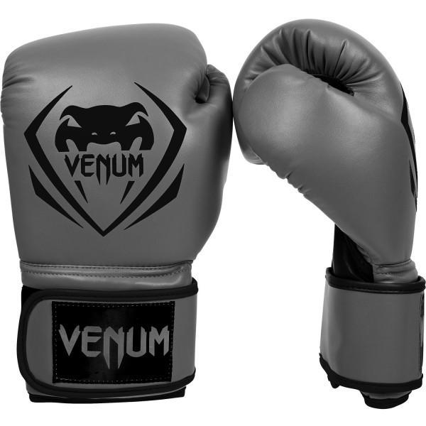 Перчатки боксерские Venum Contender - Grey, 14 oz VenumБоксерские перчатки<br>Перчатки боксерские Venum Contender- Greyвыдержат любой мощный удар, будь то джеб, кросс, хук или апперкот. Сделаны из 100% синтетической кожи с высоким сроком службы. Их изогнутая анатомическая форма обеспечивает гибкость и комфорт. Многослойный пенный наполнитель с легкостью поглащает все удары. Большая надежная застежка на липучке дает надежную фиксацию запястья, минимизируя риск возникновения травмы на тренировках. Отработка, спарринг, работа на мешках или лапах - боксерские перчаткиVenum Contender непременно приведут Вас к успеху!Особенности:- 100% синтетическая кожа с высоким сроком службы- многослойная пена для идеального поглощения ударов- широкая застежка на липучке для надежной фиксации запястья- большой палец полностью закреплен, что не дает его выбить<br>