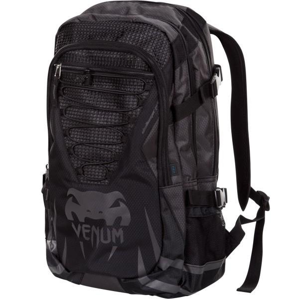 Рюкзак Venum Challenger Pro Backpack - Black/Black VenumСпортивные сумки и рюкзаки<br>Рюкзак Venum Challenger Pro Backpack -Black/BlackНовый уникальный многофункциональный рюкзак от Venum. Прекрасно подойдёт для переноски экипировки, использования в повседневной жизни или для походов на небольшие расстояния. Много карманов, специальное отделение для планшета или ноутбука диагональю до 17 дюймов. Также присутствует карман для MP3-плеера с отверстием для вывода наушников. Украшена логотипом Venum. Приятные бонусы:- Боковой карман с фиксацией для хранения питьевой бутылочки или шейкера- Водостойкая ткань из полиэфира- Очень удобная и практичная, а главное качественная - всегда пригодится!- Размер: 300 x 500 x 150 мм- Объем: 22,5 м3 / литр<br>