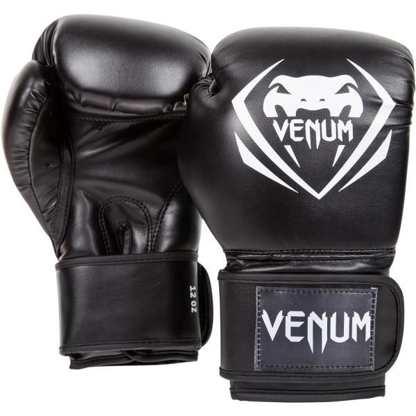 Боксерские перчатки Venum Contender, 12 oz VenumБоксерские перчатки<br>Боксерские перчатки Venum Contender. Великолепное соотношение цена/качество!Отлично защищают руку! Очень хорошо сидят на руке. Широкая застежка с резинкой, обеспечивает надежную фиксацию перчаток Venum на запястье. Внутренний наполнитель - пена для лучшей амортизации удара. Подходят и для тренировок по боксу, мма, тайскому боксу, работы на мешках, а также для соревнований определённого уровня.<br>