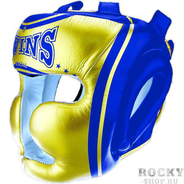 Боксерский шлем Twins Special Twins SpecialБоксерские шлемы<br>Боксерский шлем Twins Special.Специальный наполнитель (пена) обеспечивает максимальную амортизацию при ударе, а соответсвенно защищает лицо (голову).Помимо защиты самой головы, шлем так же защищает подбородок, щеки и уши.Сделано в Тайланде.Крепление- двойная застежка на задней части шлема.Данный шлем для бокса обеспечивает очень хорошую защиту головы, скул, ушей и подбородка.Внешняя обивка- кожа высочайшего качества.<br>