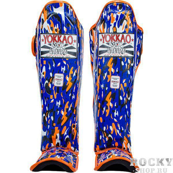 Защита голени для ММА и тайского бокса Yokkao YokkaoЗащита тела<br>Защита голени (накладки на ноги) для смешанных единоборств и тайского бокса Yokkao Apache.Данный вид шингард предназначен для особо сильной работы ногами. Поэтому эта защита голени пользуется популярностью у бойцов тайского бокса и к-1.Хорошо облегают ногу не создавая какого-либо дискомфорт бойцу.Метод крепежа- регулируемый ремешок-липучка.Предусмотрена защита не только голени, но так же суставов и связок стопы.Все швы тщательно укреплены.Продаются парой.Внешняя часть накладок - кожа высочайшего качества.<br>
