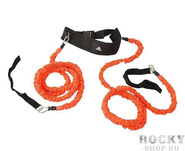 Амортизатор для скоростных тренировок Speed Resistor черно-оранжевый AdidasАксессуары для фитнеса<br>Амортизатор для скоростных тренировок Аdidas сделан из нескольких слоёв прочного текстильного материала, способного амортизировать усилие самого мощного спринт-старта. Два троса сопротивления длиной 2,4 м покрыты защитным кожухом для сохранения прочности и предотвращения их повреждения. Металлические крепления обеспечивают дополнительную надежность амортизатора. Регулируемый ремень с легко открывающейся пряжкой. Два троса сопротивления длиной 2,4 м. Универсальные крепления.<br>