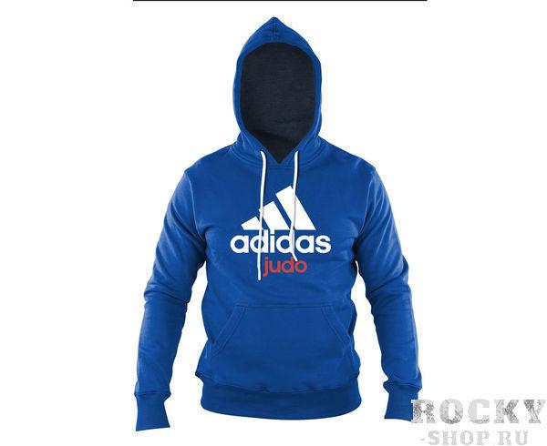 Толстовка с капюшоном (Худи) Community Hoody Judo сине-белая AdidasТолстовки / Олимпийки<br>Теплая толстовка с капюшоном, которая согреет во время тренировок в прохладную погоду. Эксклюзивная линейка COMBAT SPORT &amp; MARTIAL ARTS. Специально разработанный adidas состав приятен на ощупь и прекрасно держит тепло. Свободный крой обеспечиваетсвободудвижения при тренировке. В кармане кенгуру удобно хранить мелкие предметы. Высокая доля хлопка обеспечивает повышенную износостойкость материала. Логотип adidas и надпись JUDO. Толстовку можно носить как на тренировках, так и в качестве повседневной одежды.  Эксклюзивная линейка COMBAT SPORT &amp; MARTIAL ART Материал angeraut Регулируемый капюшон со шнурком Рифленые манжеты и нижний край Крупная контрастная надпись adidas на лицевой стороне Карман кенгуру Состав: 80% хлопок, 20% полиэстр<br><br>Размер INT: L
