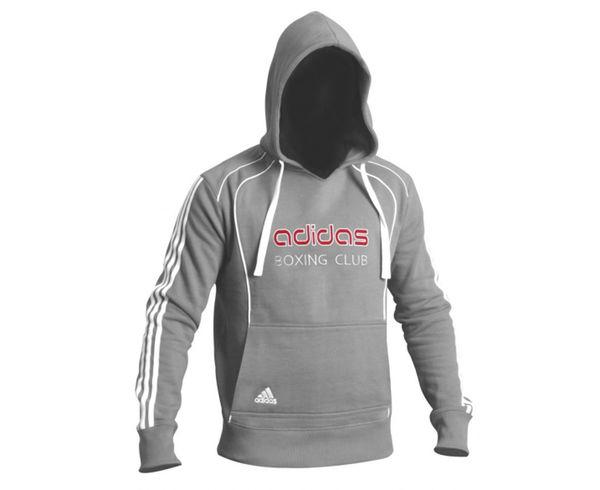 Толстовка с капюшоном (Худи) Hoody Sweat Boxing Club, серая AdidasТолстовки / Олимпийки<br>Теплая толстовка с капюшоном, которая согреет во время тренировок в прохладную погоду. Эксклюзивная линейка COMBAT SPORT &amp; MARTIAL ARTS. Специально разработанный adidas состав приятен на ощупь и прекрасно держит тепло. Свободный крой обеспечиваетсвободудвижения при тренировке. В кармане кенгуру удобно хранить мелкие предметы. Высокая доля хлопка обеспечивает повышенную износостойкость материала. Логотип adidas и надпись BOXING CLUB. Толстовку можно носить как на тренировках, так и в качестве повседневной одежды. Эксклюзивная линейкаCOMBAT SPORT &amp; MARTIAL ARTS Материал angeraut Регулируемый капюшон со шнурком Рифленые манжеты и нижний край Крупный контрастный логотип adidas на лицевой стороне Карман кенгуру Состав: 80% хлопок, 20% полиэстер<br><br>Размер INT: M