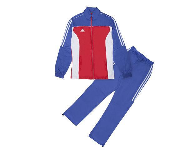 Костюм спортивный детский Tracksuit Martial Arts Kids, сине-красно-белый AdidasСпортивные костюмы<br>Этот яркий детский костюм идеально подойдет как для занятий спортом, так и для повседневной носки. Контрастная расцветка, воротник-стойка и свободные манжеты на брючинах с регулировкой для максимального комфорта и подгонки размера. Куртка: передние карманы на молнии, застежка на молнию, воротник-стойка, эластичные манжеты и нижний край. Брюки: боковые карманы на молнии, эластичный пояс, регулируемые манжеты на брюках. Классический крой. Из 100% полиэстера.  Контрастная расцветка Лаконичный дизайн Регулируемые манжеты на брюках Классический крой Состав: 100% полиэстер<br><br>Размер INT: рост 164 см