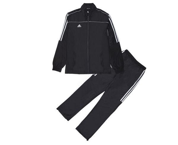 Костюм спортивный Tracksuit Martial Arts, черный AdidasСпортивные костюмы<br>Этот лаконичный черный костюм идеально подойдет как для занятий спортом, так и для повседневной носки. Контрастная расцветка, воротник-стойка и свободные манжеты на брючинах с регулировкой для максимального комфорта и подгонки размера. Куртка: передние карманы на молнии, застежка на молнию, воротник-стойка, эластичные манжеты и нижний край. Брюки: боковые карманы на молнии, эластичный пояс, регулируемые манжеты на брюках. Классический крой. Из 100% полиэстера. Контрастнная расцветка Лаконичный дизайн Регулируемые манжеты на брюках Классический крой Состав: 100% полиэстер<br><br>Размер INT: XS