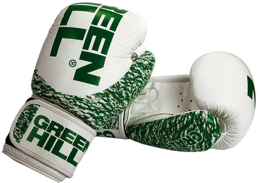 Перчатки боксерские craze, 10 oz Green HillБоксерские перчатки<br>Материал: Натуральная кожаПреимущество перчаток из натуральной кожи - это их удобство и долговечность. Высокотехнологичная вставка из пенополиуретана сделана таким образом, что принимает форму руки спортсмена, обеспечивая максимальный комфорт и позволяет чувствовать удар. Липучка на запястье фиксирует кисть в нужном положении. Обеспечивают высокий уровень защиты кистей рук.<br><br>Цвет: белый/зеленый