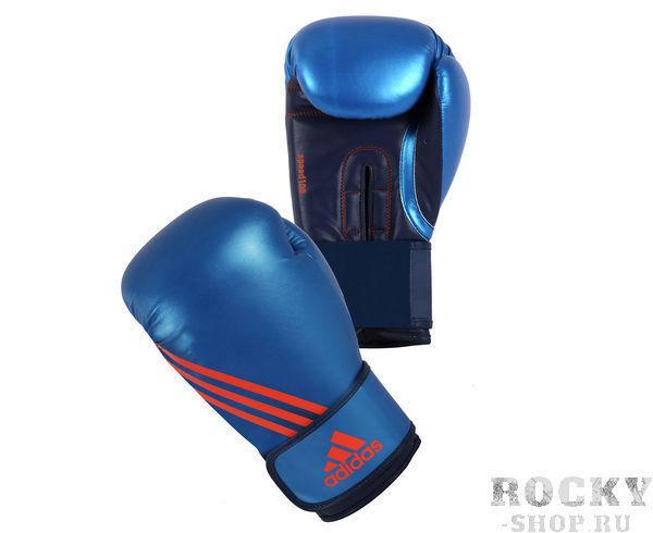 Перчатки боксерские Speed 100 сине-оранжевые, 14 унций AdidasБоксерские перчатки<br>Боксерские перчатки adidas Speed 100 позволяют спортсмену реализовать свою силу и скорость на 100%. Они изготовлены из полиуретана нового поколения по технологии PU3G INNOVATION.PU3G - этомягкий и прочныйполиуретан, который выглядит, как кожа, и нечувствителен к колебаниям температуры и влажности. ПерчаткаSpeed 100 сделана из многослойного литого блока пенывысокого давления IMF (Intelligent Mould Technology). Уникальность этой технологии заключается в том, форма придается перчатке вручную. Это обеспечивает боксеру невероятно удобную посадку перчатки на руку и легкость в тренировке, быстроту и скорость в нанесение удара, а также оптимальный уровень безопасности партнера во время тренировки. Перчатка снабжена новой системой липучек Strap-Up® для быстрой и точной регулировкой боксерских перчаток.Логотип adidas и три полосы в оригинальном оранжевом цвете.Состав: 100% полиуретан.      Инновационная технология adidas SPEED®   Технология PU3GINNOVATION®   Технология I-Protech®   ТехнологияStrap-UP®   Оригинальный дизайн   Ширина манжета 6,5 см.   100% полиуретан.<br>