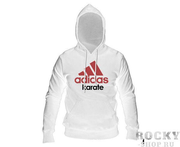 Толстовка с капюшоном (Худи) Community Hoody Karate бело-красная AdidasТолстовки / Олимпийки<br>Теплая толстовка с капюшоном, которая согреет во время тренировок в прохладную погоду. Эксклюзивная линейка COMBAT SPORT &amp; MARTIAL ARTS. Разработанный adidas состав ткани, приятен на ощупь и прекрасно держит тепло.Свободный крой обеспечиваетсвободудвижения при тренировке.В кармане кенгуру удобно хранить мелкие предметы. Высокая доля хлопка обеспечивает повышенную износостойкость материала. Логотип adidas и надпись KARATE. Толстовку можно носить как на тренировках, так и в качестве повседневной одежды.      Эксклюзивная линейка COMBAT SPORT &amp; MARTIAL ART.      Материал angeraut.      Регулируемый капюшон со шнурком.      Рифленые манжеты и нижний край.      Крупная контрастная надпись adidas на лицевой стороне/      Карман кенгуру .      Состав: 80% хлопок, 20% полиэстр<br>