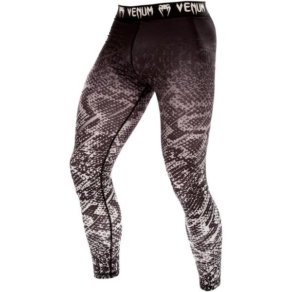 Компрессионные штаны Venum Tropical Black/Grey VenumКомпрессионные штаны / шорты<br>Компрессионные штаны Venum Tropical Black/Grey очень удобные и хорошо подойдут для тренировок и выступлений по всем видам борьбы. Позволят повысить Вашу производительность при максимальной степени комфорта. Хорошо держат мышцы во время самых интенсивных упражнений. Обеспечивают ускоренное восстановление мышц. Эластичная ткань защищает от опрелостей, раздражений и микробов. Особенности:- состав 87% полиэстер / 13% спандекс- компрессионная технология Venum обеспечивает равномерное давление на мышцы по всей их поверхности, что позволяет выдерживать бОльшие нагрузки и быстрее восстанавливаться- позволяют выполнять полный диапазон движений- технология Dry Tech выводит влагу и оставляет тело в сухости- эргономичные усиленные швы и резинка на талии- супер мягкий и прочный, комфортный материал<br><br>Размер INT: M