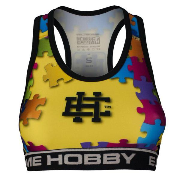 Топ женский puzzle (желтый) Extreme HobbyМайки<br>Отличного качества женский топ Extreme Hobby является идеальным выбором для людей, активно занимающихся тренировками, которые ценят высокий класс продуктов. Изготовлен из современного материала, который благодаря своей структуре идеально садится по фигуре. Продуманная система терморегуляции, с помощью которого тело остается сухим, а мышцы разогретыми. Логотипы нанесены по технологии сублимации. Специальная резинка под грудью предотвращает скольжение во время занятий спортом. <br>КОЛЛЕКЦИЯ: SPORT<br>ЦВЕТ: ЖЕЛТЫЙ<br>МАТЕРИАЛ: 82% ПОЛИЭСТЕР 18% ЭЛАСТАН<br><br>Размер INT: M