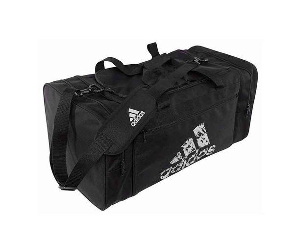 Сумка спортивная Team Bag M черная AdidasСпортивные сумки и рюкзаки<br>Модель 2017 года. Коллекция adidas martial arts &amp;amp; boxing &amp;amp;&amp;nbsp; Эта просторная спортивная сумка adidas является потребностью&amp;nbsp;любого вида единоборств. Как для тренировок так и для соревнований. &amp;nbsp; Боковые карманы. &amp;nbsp;Материал: 100% полиэстер, внутри нейлон. &amp;nbsp;Размеры:&amp;nbsp;M = 55 x 28 x 28см&amp;nbsp;- 40&amp;nbsp;Литров. &amp;nbsp;<br><br>Размер: M
