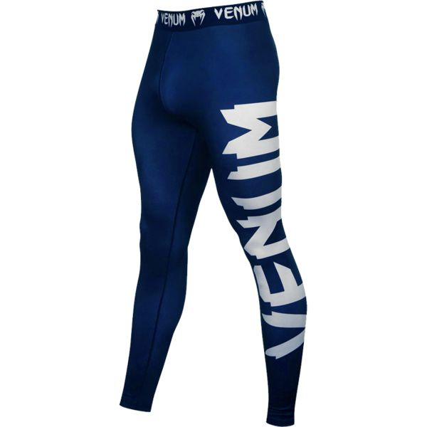 Компрессионные штаны Venum Giant VenumКомпрессионные штаны / шорты<br>Компрессионные штаны Venum Giant. С этими компрессионками от Venum вы будете думать только о тренировочном процессе, не отвлекаясь на неприятные ощущения в мышцах ног. Предназначены для улучшения кровообращения в мышцах, что, в свою очередь, способствует уменьшению времени на восстановление полной работоспособностимышцы. Прекрасно сидят на любом теле, хорошо тянутся, абсолютно НЕ сковывают движения. Очень приятная на ощупь ткань. Штаны Venum достаточно быстро сохнут. Плоские швы не натирают кожу. Предназначены для занятий самыми различными единоборствами, кроссфитом, фитнесом, железным спортом и т. д. . Уход: Машинная стирка в холодной воде, деликатный отжим, не отбеливать.<br><br>Размер INT: XXL