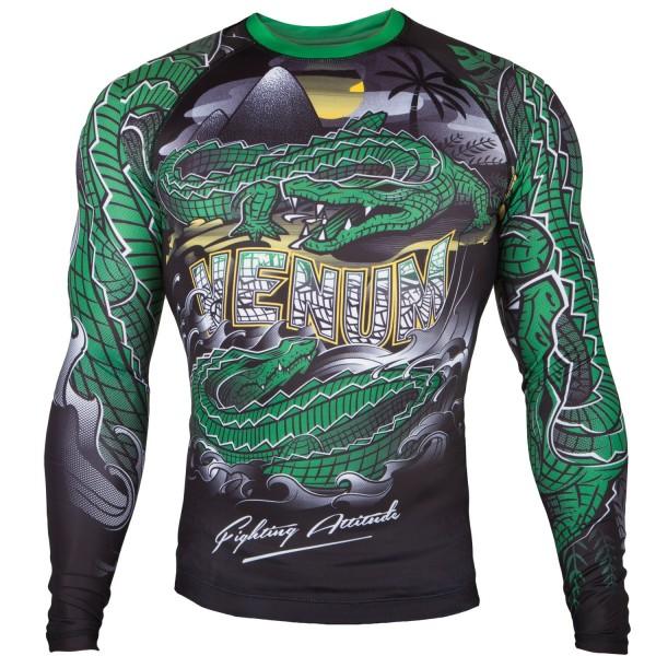 Рашгард Venum Crocodile Black/Green L/S VenumРашгарды<br>Рашгард Venum Crocodile Black/Green L/S: стань супер-хищником. Сокруши своих соперников в грозном рашгарде Venum Crocodile Dry Tech. Повысь свою выносливость благодаря, компрессионной технологии Venum и стань неутомимым хищником на ринге. 87% полиэстер и 13% спандекс: ткань, известная своей эластичностью и прочностью. Компрессионная технология Venum улучшает кровообращение мышц и ускоряет процесс восстановления. Технология Venum Dry Tech обеспечивает оптимальный контроль температуры тела. Рисунок сублимирован в ткань для повышения его износостойкости. Особый эргономичный покрой рашгарда не оставляет шансов противнику. Усиленные швы. Благодаря эластичной ленте, расположенной на талии, рашгард плотно прилегает к телу и не задирается во время боя.<br><br>Размер INT: L
