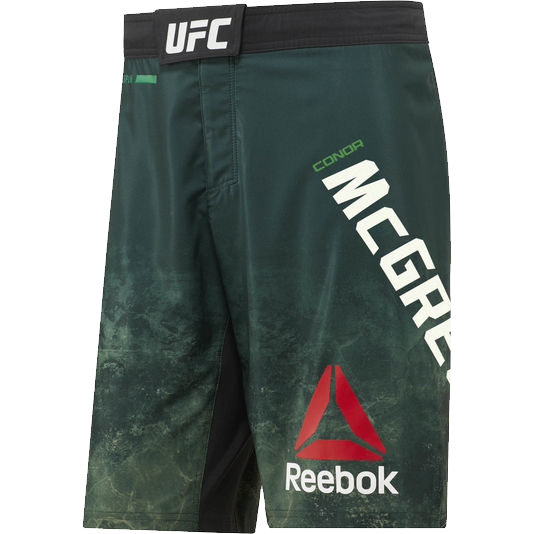 Шорты Reebok McGregor ReebokШорты ММА<br>Бойцовские шорты Reebok UFC Conor McGregor Octagon. Официальные шорты Конора The Notorious Макгрегора от Reebok UFC. Материал: полиэстер / эластан, тканый материал для эластичности, комфорта и полной свободы движений. Пояс на удобной застежке-липучке. Технология Speedwick эффективно отводит лишнюю влагу, обеспечивая сухость и комфорт. Разрезы по бокам и эластичная в 4-х направлениях ткань гарантируют полную свободу движений. Уход: машинная стирка в холодной воде, не отбеливать.<br><br>Размер INT: XXL