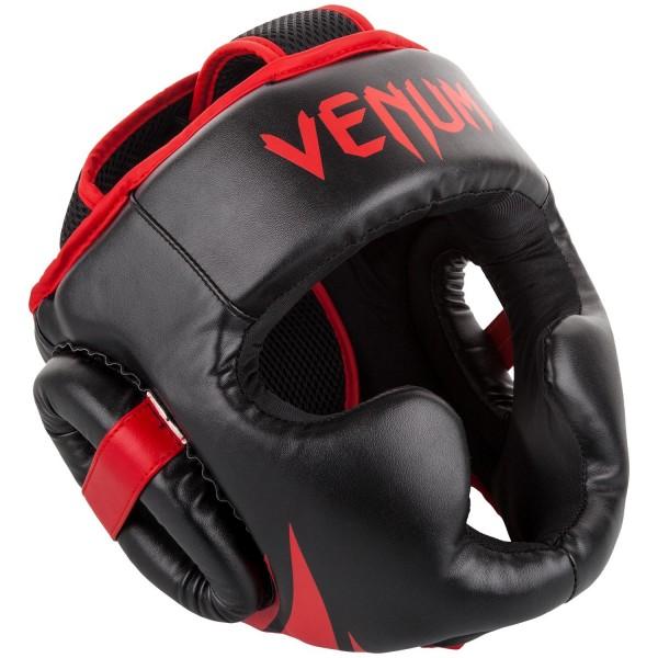 Шлем боксерский Venum Challenger 2.0 Neo Black/Red VenumБоксерские шлемы<br>Для серьезных испытаний нужен серьезный шлем, аVenum Challenger 2. 0 -Neo Black/Redкак раз из таких!Разработан в Тайланде из кожи Skintex, пожалуй, самый совершенный шлем по доступной цене. Ультра-легкий с превосходным обзором. Его конструкция обеспечивает полную защиту со всех сторон, включая защиту таких чувствительных областей, как виски, подбородок и щеки. Погружайтесь в игру с головой, с полностью защищенной головой!Особенности:- Построен из кожи Skintex- Ультра-легкий- Три слоя пены внутри- Защита висков, щек, ушей и подбородка- Застегивается на липучке в двух плоскостях- Единый, настраиваемый размер- Производство Китай.<br><br>Размер: 0