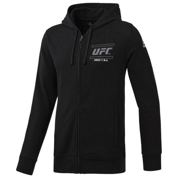 Худи Reebok UFC FG ReebokТолстовки / Олимпийки<br>Худи Reebok UFC FG. Официальная кофта UFC Reebok. Худи из мягкого трикотажа с символикой UFC спереди, на спине и сбоку. В боковые карманы можно сложить необходимые мелочи. Идеально для разного вида тренировок и на каждый день, оценят поклонники UFC. Облегающий крой отлично подходит для тренировок и совершенно не стесняет движений. Молния во всю длину и капюшон на шнурке. Материал: 80% хлопок, 20% полиэстер. Уход: машинная стирка в холодной воде, деликатный отжим, не отбеливать.<br><br>Размер INT: XXL