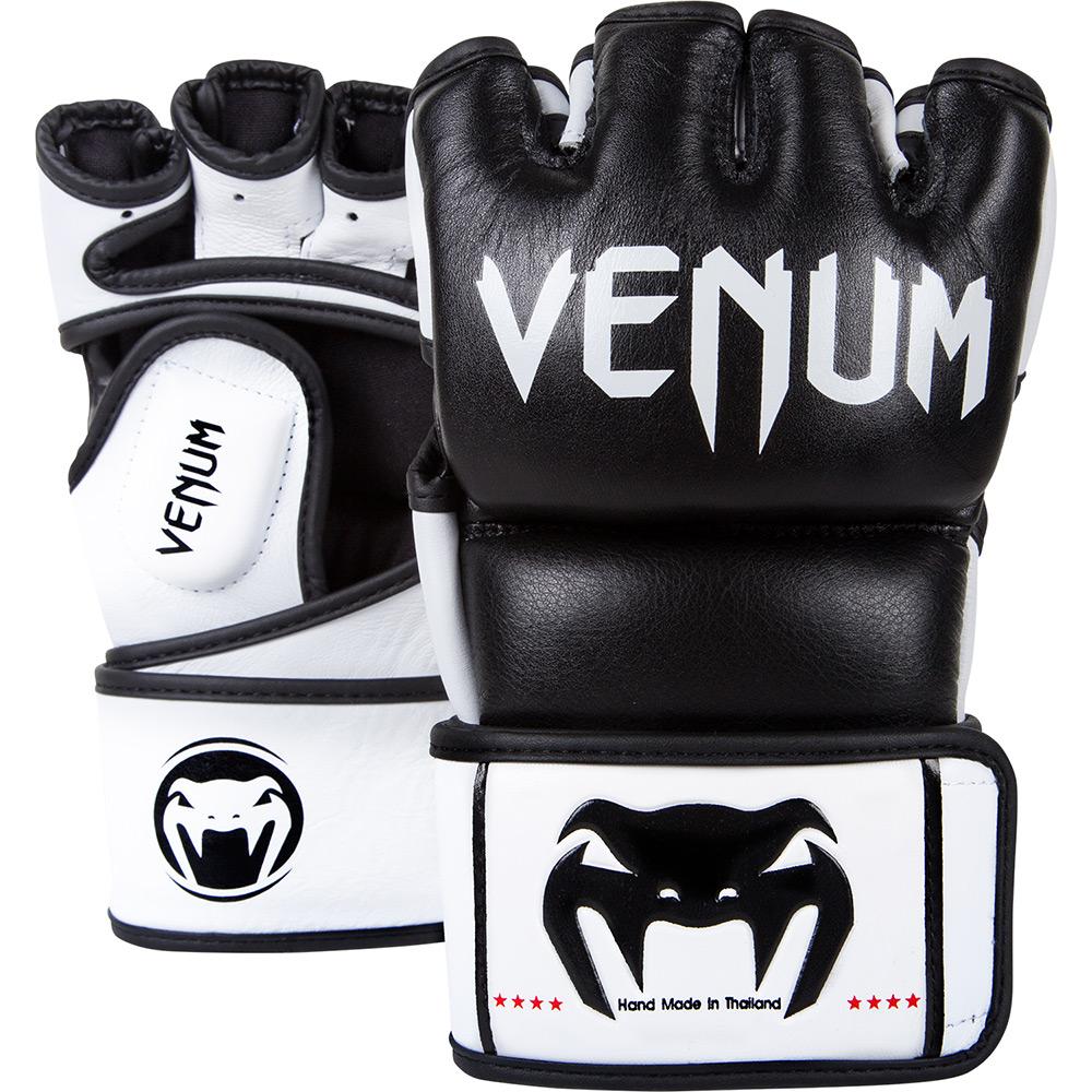 Перчатки ММА Venum Undisputed Gloves - Nappa Leather Black VenumПерчатки MMA<br>&amp;nbsp;Перчатки ручной работы сделаны в Таиланде из высококачественной кожи Nappa. Разработаны с целью обеспечить комфорт и максимальную эргономичность, и долговечность. &amp;nbsp;- лучшая кожа на рынке - Nappa&amp;nbsp;- воздушная пена для лучшей защиты и поглощения удара&amp;nbsp;- комфортные отверстия для пальцев&amp;nbsp;- два ремня для регулировки затяжки на запястье&amp;nbsp;- теснение на коже<br><br>Размер: M