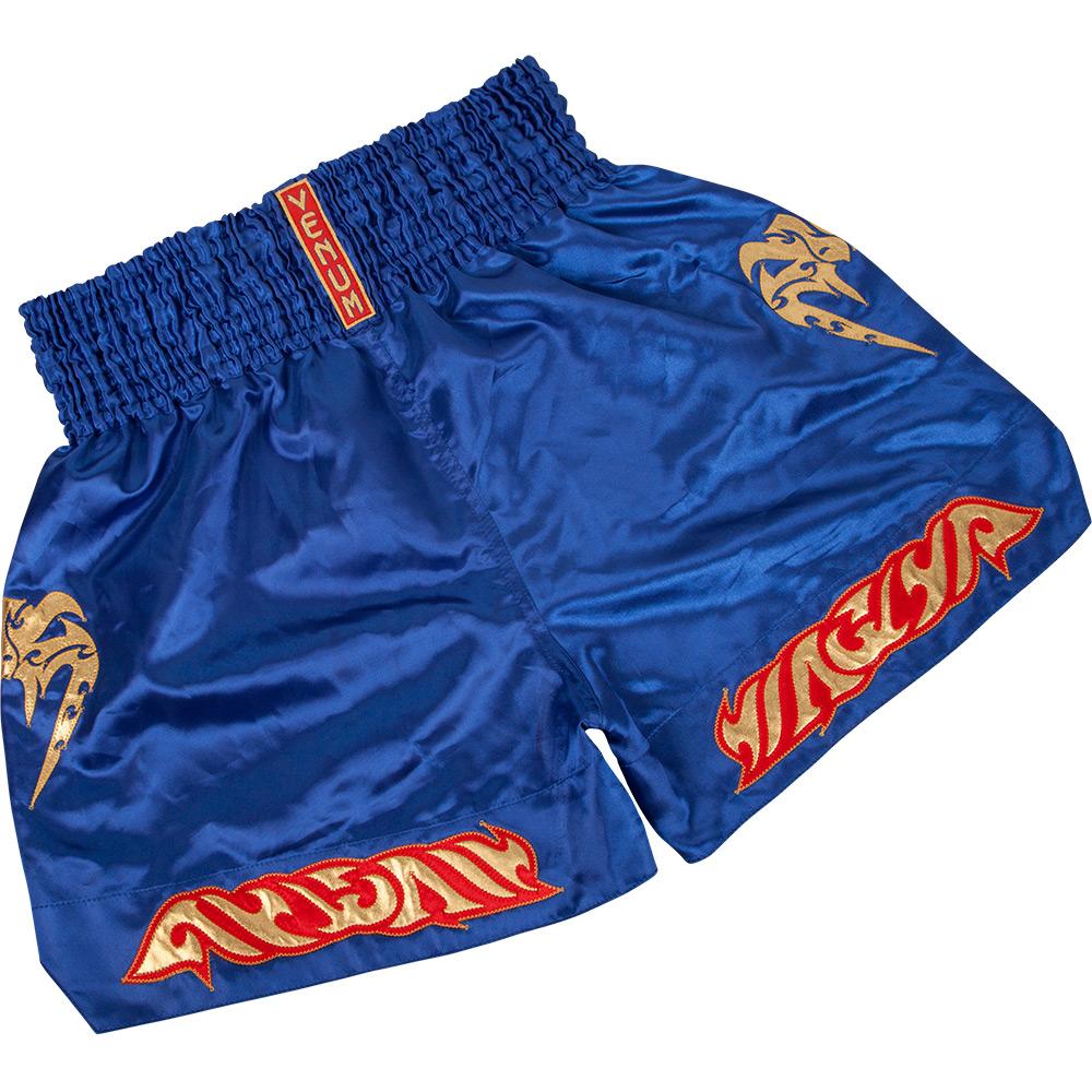 Шорты тайские Venum Tribal Muay Thai Shorts - Blue VenumШорты для тайского бокса/кикбоксинга<br>Радуем вас новинками от Venum. Представляем вам новые шорты Venum Tribal Muai Thai shorts. Выполнены в неповторимом тайском стиле. Идеально подходят для всех типов единоборств где разрешенны удары ногами. &amp;nbsp;В этих шортах ваши движения будут лёгкими и нескованными. Вышитые логотипы Venum спереди и сзади. Материал -полиэстер. Лёгкие и практичные. Удобная широкая резинка.<br><br>Размер INT: XXL