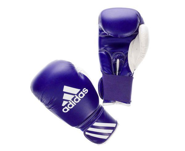 Перчатки боксерские Response, 12 унций AdidasБоксерские перчатки<br>Перчатки боксерские adidas Response сине-белые.     Тренировочные боксерские перчатки на липучке.   Полиуретан по технологии PU3G INNOVATION.   Композитный литой вкладыш из пены высокого давления.   Усиленная защита большого пальца, ладони, уcиление ударной зоны.   Специальная жесткая манжета для защиты кисти.<br><br>Цвет: черно-красные