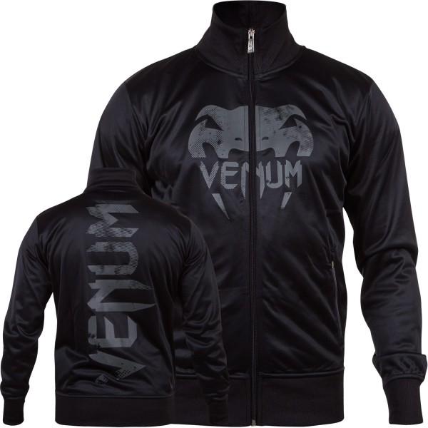 Олимпийка Venum Giant Grunge Track Jacket Black/Grey VenumТолстовки / Олимпийки<br>Олимпийка Venum Giant Grunge Track Jacket Black/Grey - на гребне волны спортивной моды, благодаря смелому и стильному дизайну. Эта олимпийка - дань уважения всем бойцам, которые постоянно совершенствуют себя в высокой конкурентной среде. Год за годом компания Venum улучшает свои технологии и создает подобные вещи. Состоит из очень комфортной мягкой и прочной ткани. Спортивный крой обеспечивает свободу движений. Боковые карманы на молнии для безопасного хранения Ваших вещей. Особенности:Большие логотипы спереди и сзадиМолния до подбородкаСпортивный кройБоковые карманы<br><br>Размер INT: M