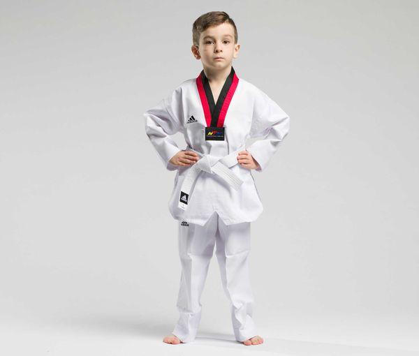 Добок для тхэквондо WTF Adi-Start, белый с красно-черным воротником AdidasЭкипировка для Тхэквондо<br>Adi-start. Добок для тхэквондо WTF.    Белое с красно-черным воротом, без пояса.   WTF approved  Классическая ребристая ткань  Пояс на штанах на резинке +фиксирующая веревка  Отличный выбор для начинающего спортсмена  Материал: 80% полиэстер 20% хлопок<br><br>Размер: 110 см
